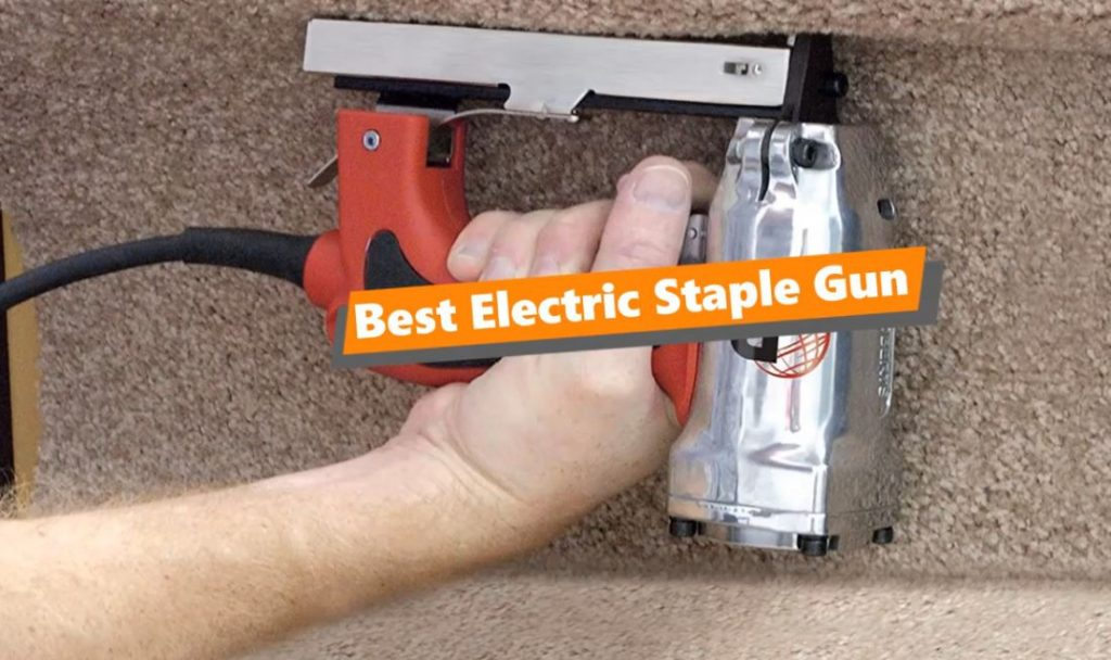 A man's hand holds one of the best electric staple guns on the market today