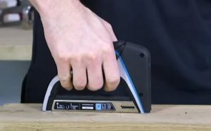The Arrow Fastener T50X TacMate Stapler is used by a man's hand